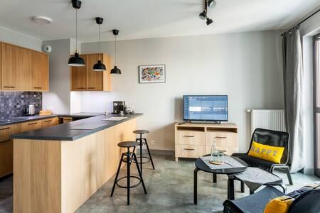 Apartament Grafitowy – blisko centrum z garażem