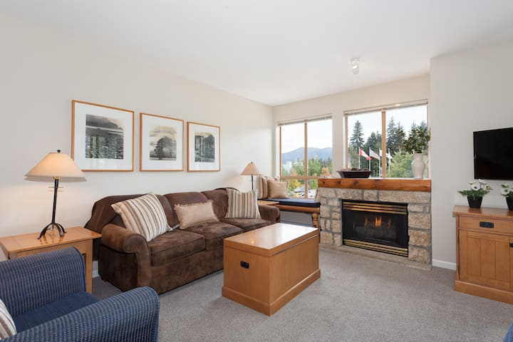Sit by the cozy gas fireplace and take in the views