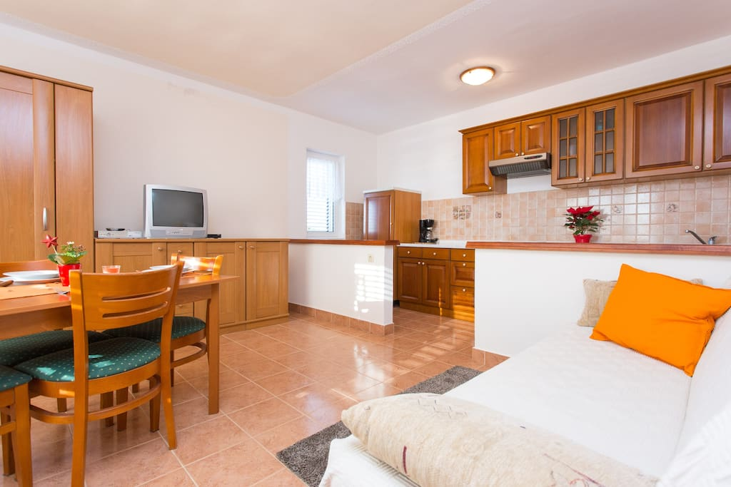 Kitchen with dining room. Kitchen has everything what you need for your stay. There are also 2 sofa where can sleep 2 adults, tv, wifi