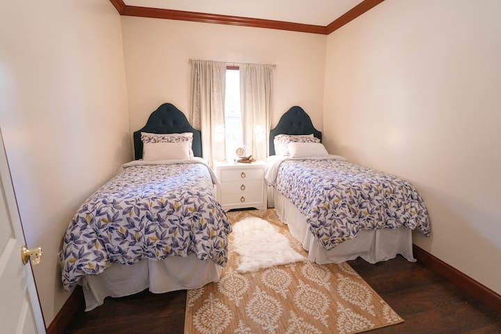 Beautiful 2nd bedroom with two twin beds, convenient for different types of groups. Memory foam mattresses and a lamps for each guest.