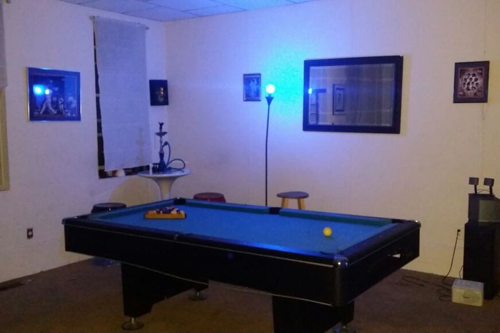 Game room with pool table, & card games