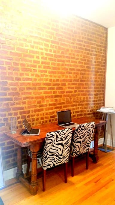 Office with extra long desk (seats 2). Equipped with copier, printer and internet.