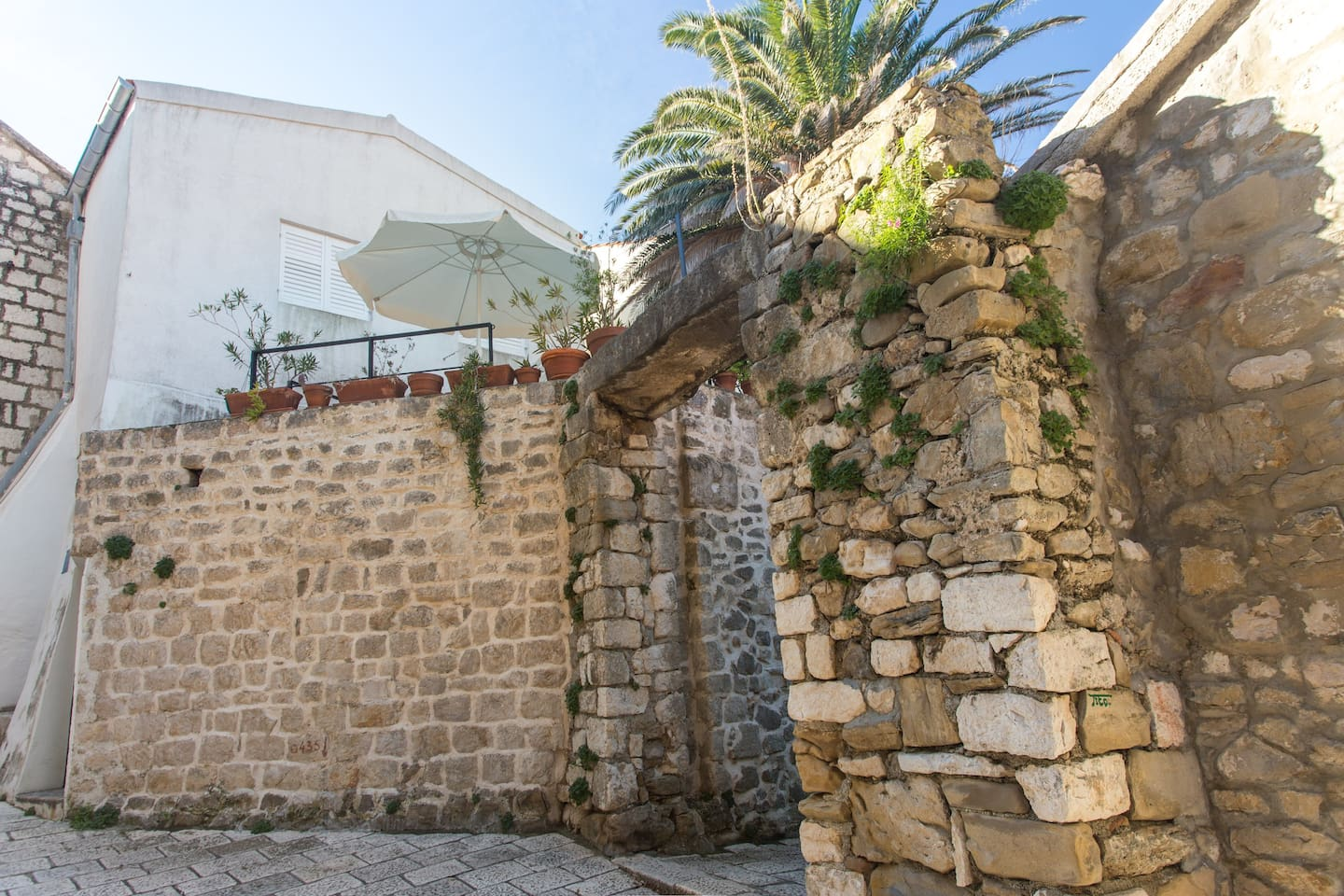 street view of house and terrace - apartment in newly renovated mediterranean style stone house