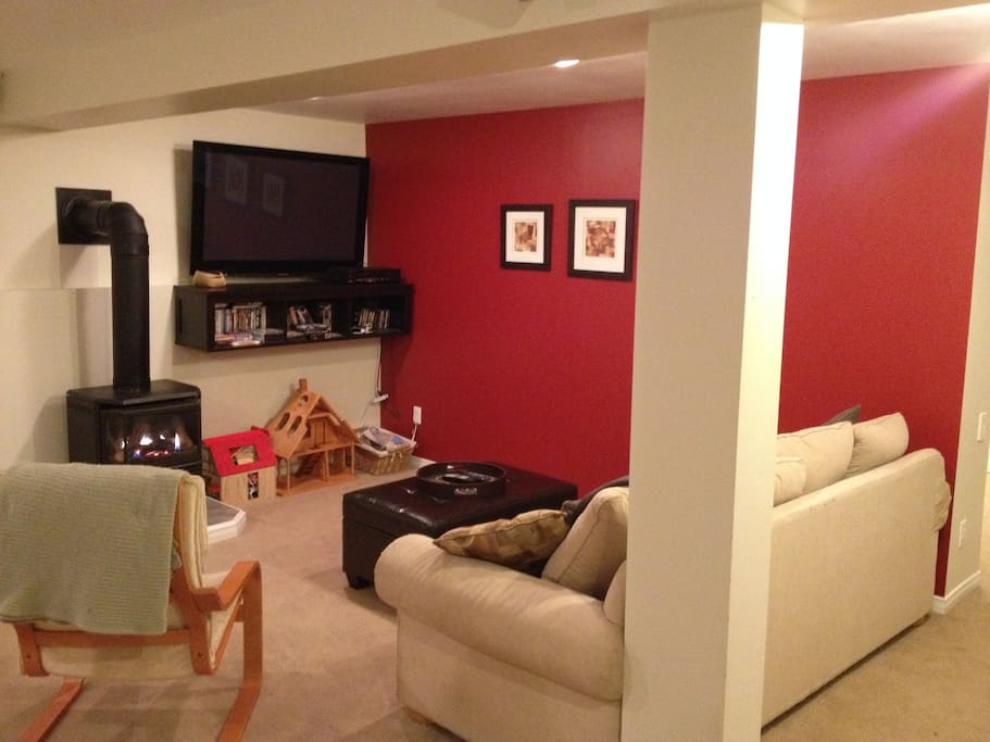Cozy finished basement with fireplace & entertainment