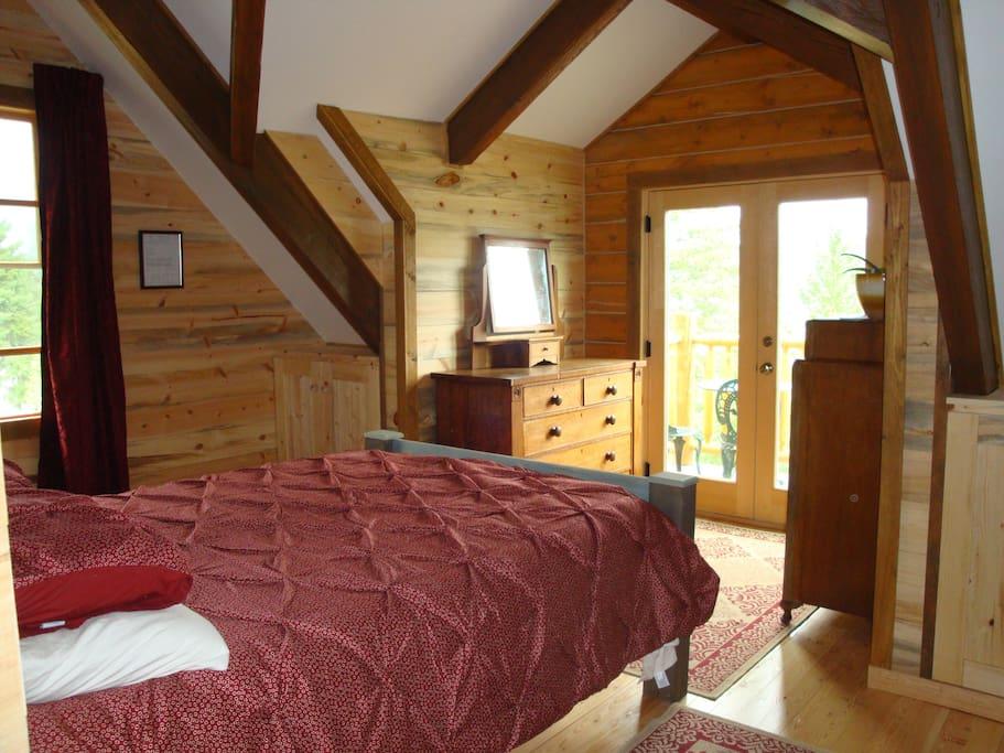 Queen size bed in cosy beamed bedroom.