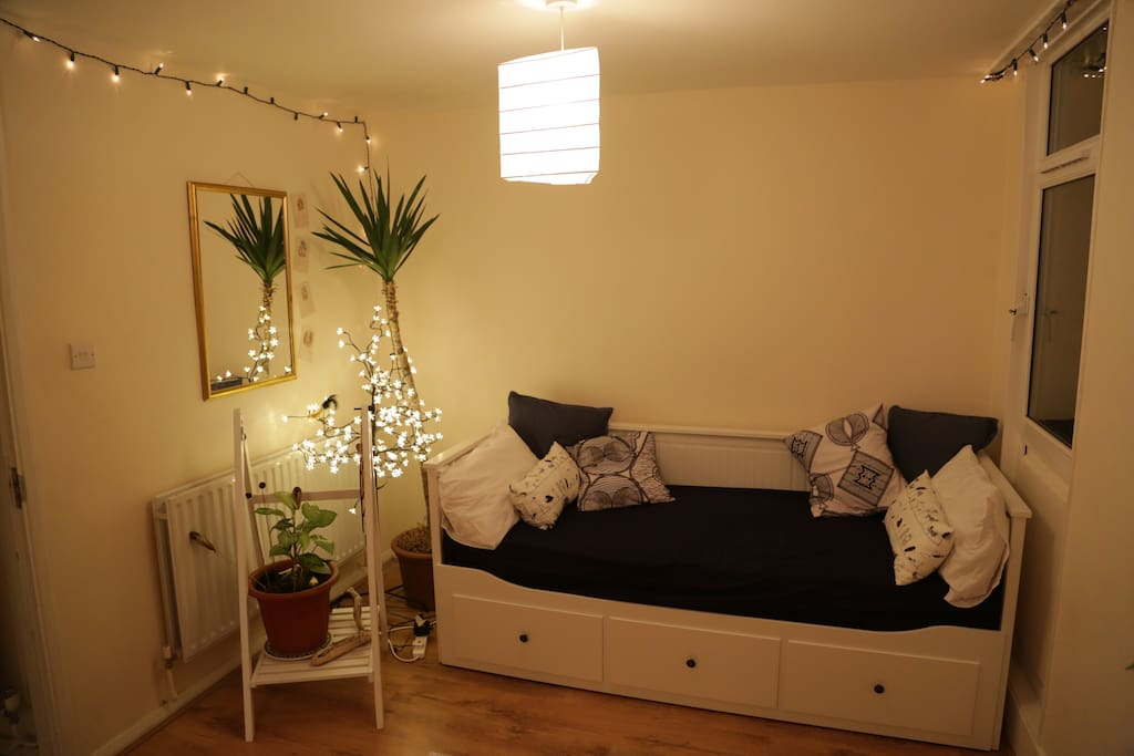 The room at night, with bed as a single.
