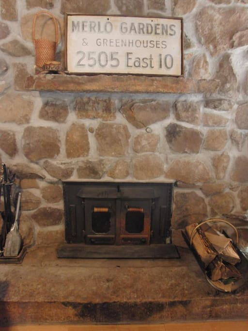 Fireplace fashioned with stones from the property.