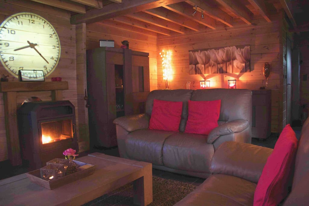 Relax in the comfortable leather sofa's by the log fire.