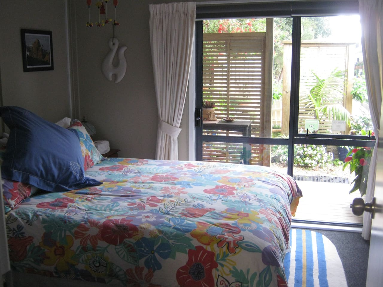 A Side view of the Queen size Bed with the private entry ranch slider.