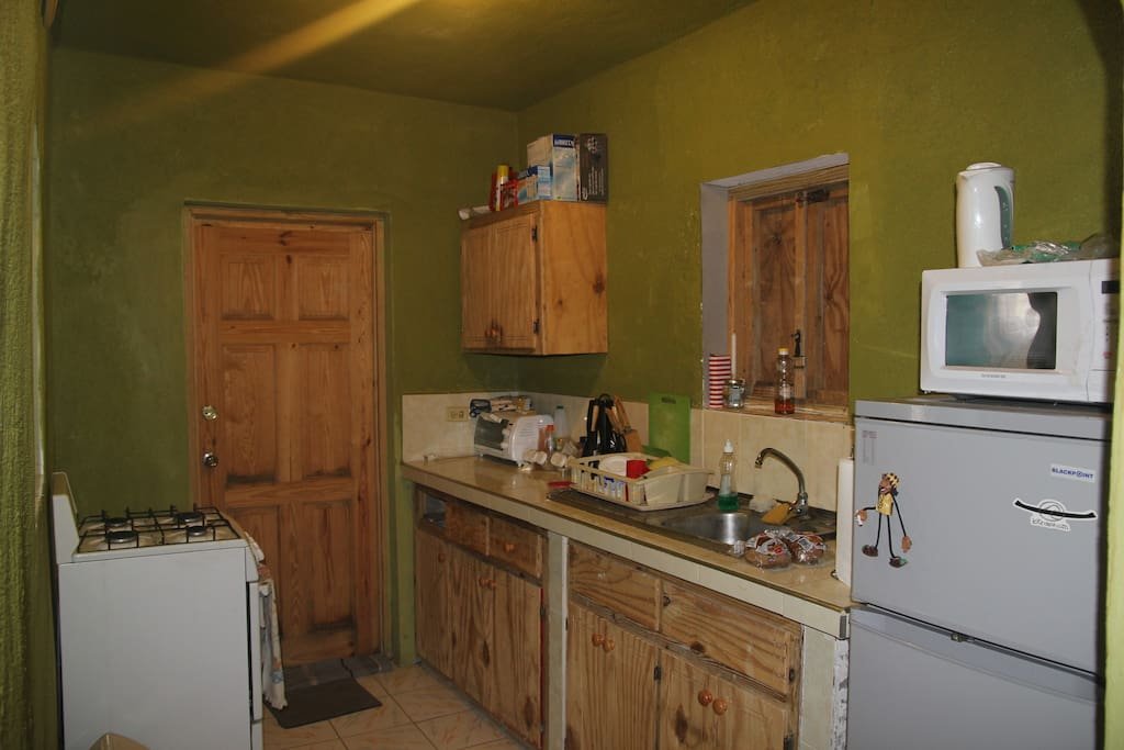 furnished kitchen, with stove refrigerator, microwave, toaster oven and utensils. WiFi