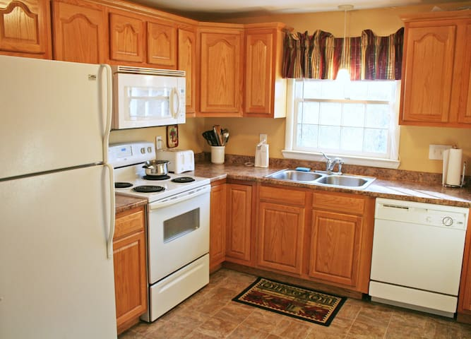 Bedroom is part of a unit that includes shared kitchen, as well as bathroom and living room.