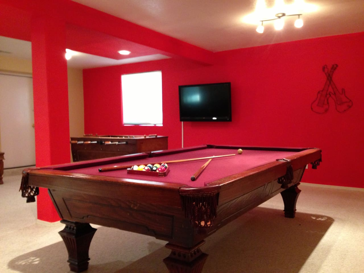 Huge Entertainment room in bottom floor. Can also be used as a third bedroom and there is a sleeper sofa in the room.
