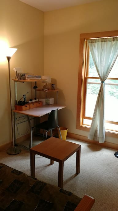 Smaller bedroom with desk, TV and couch. Can be converted to 2nd bedroom.
