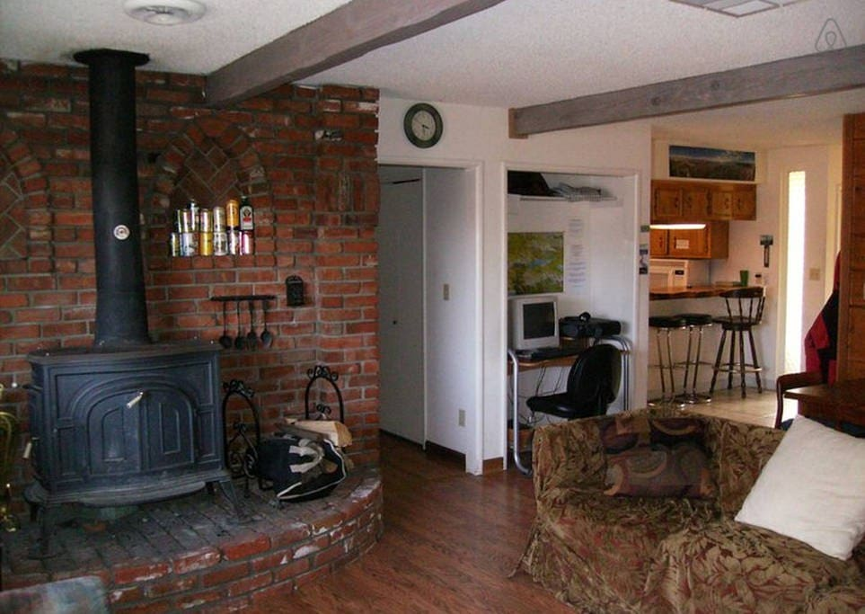 Wood stove in living room. All rooms also have central heating.