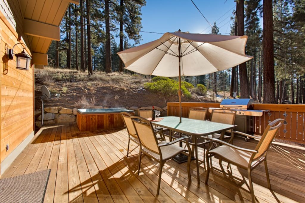 Spacious deck with hot tub, bbq, and views