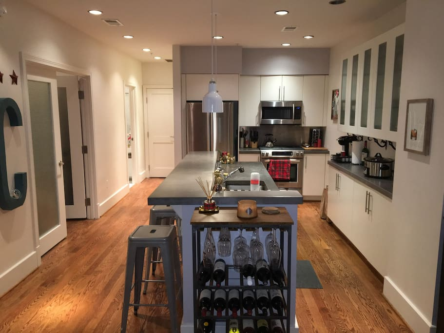 Kitchen w/ high end stainless appliances and 4 barstools