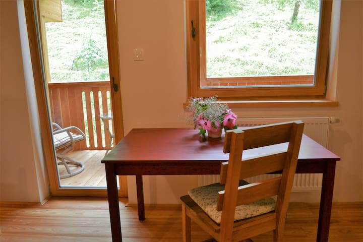 Dining table, can also be used as working space. Entrance to the balcony.