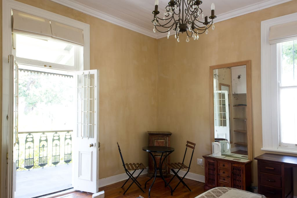 Double doors leading from main bedroom onto balcony overlooking Table Mountain and Devils Peak
