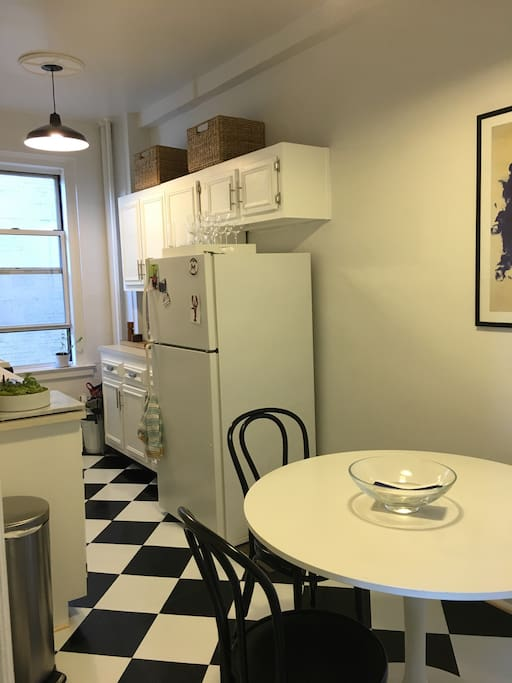 Bright, fully equipped, spacious kitchen with a comfy spot to read the NY Times over coffee.