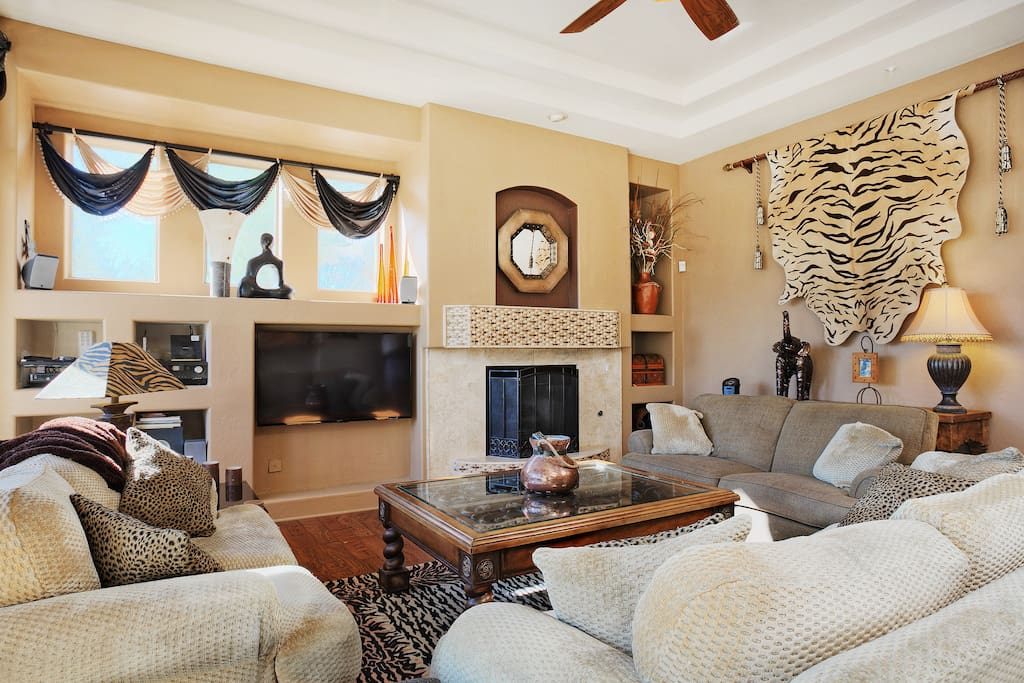 Plush seating and cozy gas fireplace in the family room.