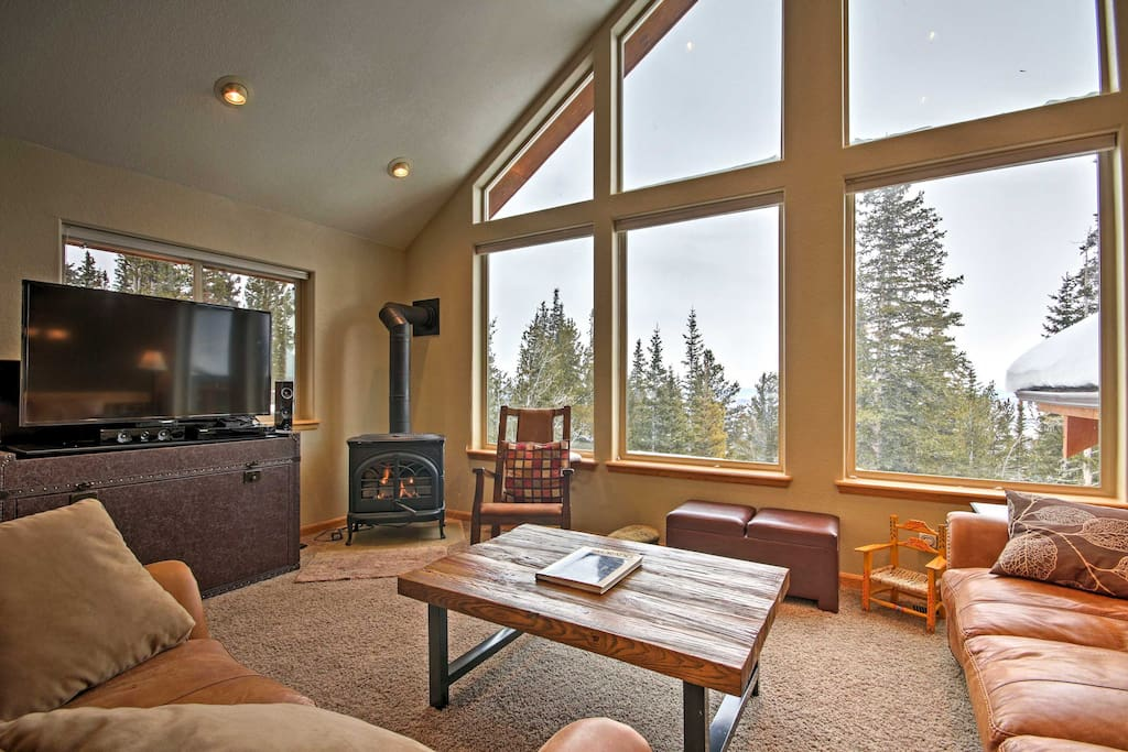 Large windows in the living area offer splendid views of the beautiful outdoors.