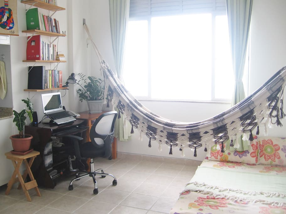 Work area, hammock, bed, and a large window with view on the sea!