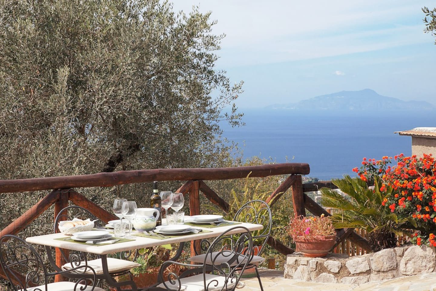 The views are lovely, with the blue of the Gulf of Naples framed on each side by green treetops and russet rooftops.