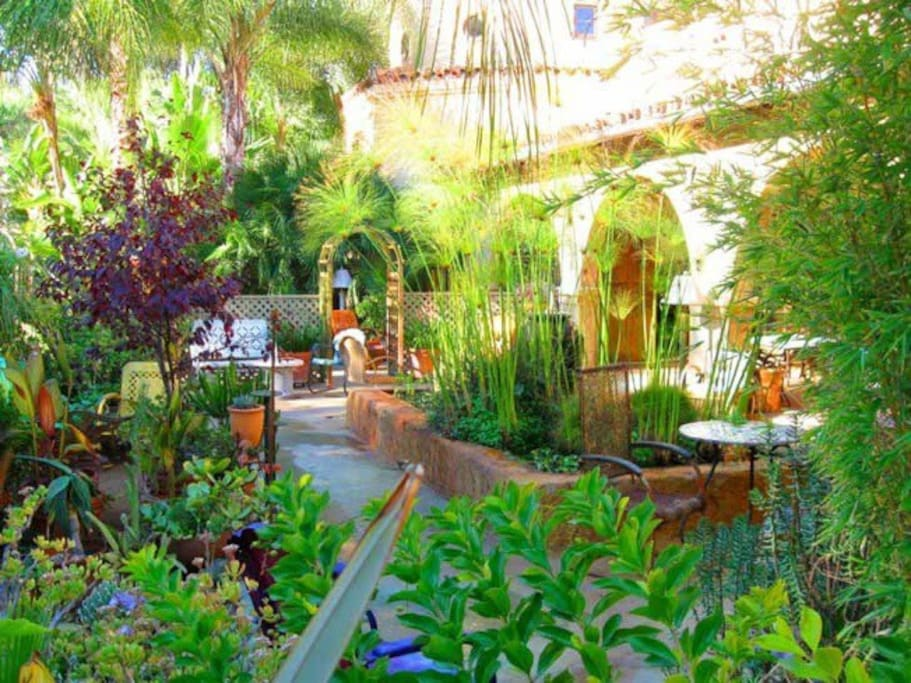 ...surrounded by an acre of lush patios and gardens...