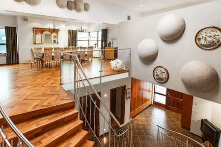 Price from €450. 370 square meter lux. Villa, 15 min. drive to down town Reykjavík. 6 bedrooms, sleeps 14, 2.5 bathrooms, fully equipped kitchen, spacious living-room with a projector, big garden with a Jacuzzi, private parking for 5-6 cars.