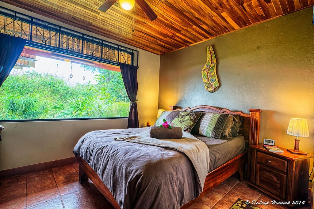 Romantic Queen Room with Hand Made Furniture & Local Artwork.