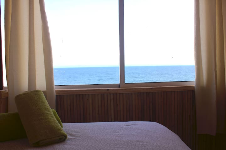 View overlooking the Atlantic Ocean from on top of the bed