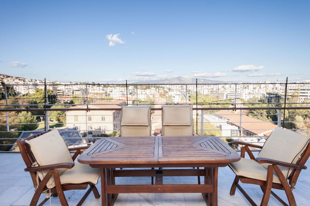 Unobstructed view to Athens, Penteli and Ymittos mountains. Terrace in front of the living room.