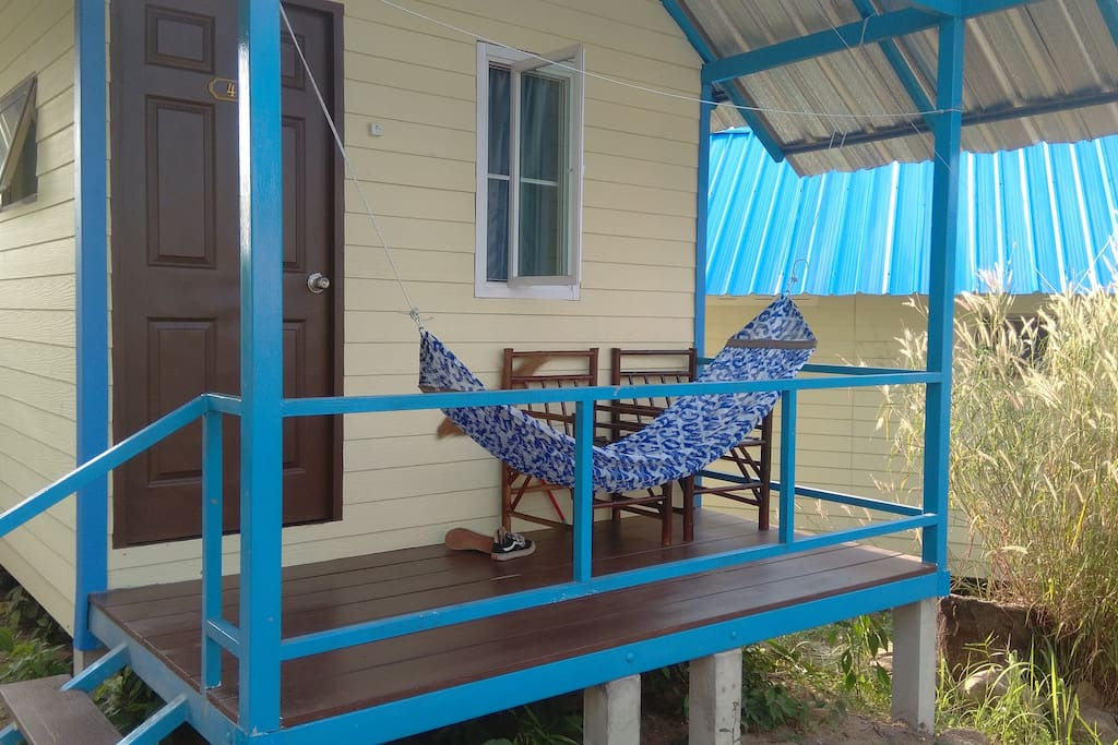 Our bungalow balcony with 2 chairs and a hammock