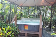 Soak in the hot tub surrounded by bamboo and palms and lit by Tiki torches at night.