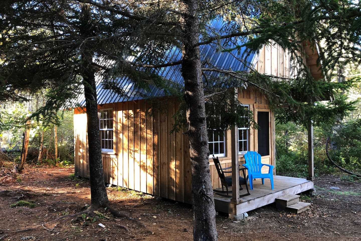 Forest-shaded cabin is located on east side of Long Island in Friendship, Maine (Muscongus Bay), a short boat ride (.75 miles) from town landing/parking on beautiful Friendship Harbor. From front porch of the cabin to high-tide water's edge is about 80 feet.