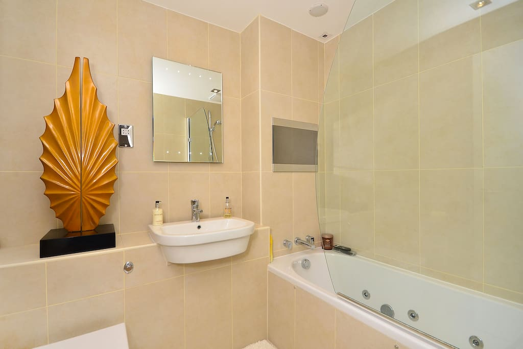 Your bathroom is right next to your bedroom. Shower, jacuzzi bath and full Sky TV.
