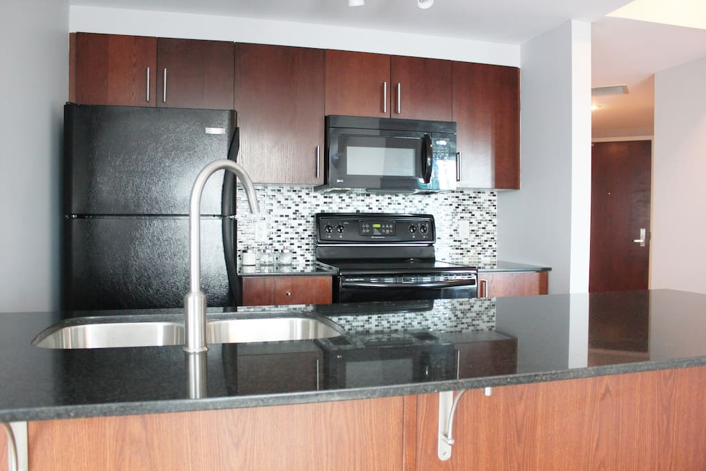 Updated kitchen with everything you need - refrigerator, electric oven/stove, microwave, dishwasher, Keurig.