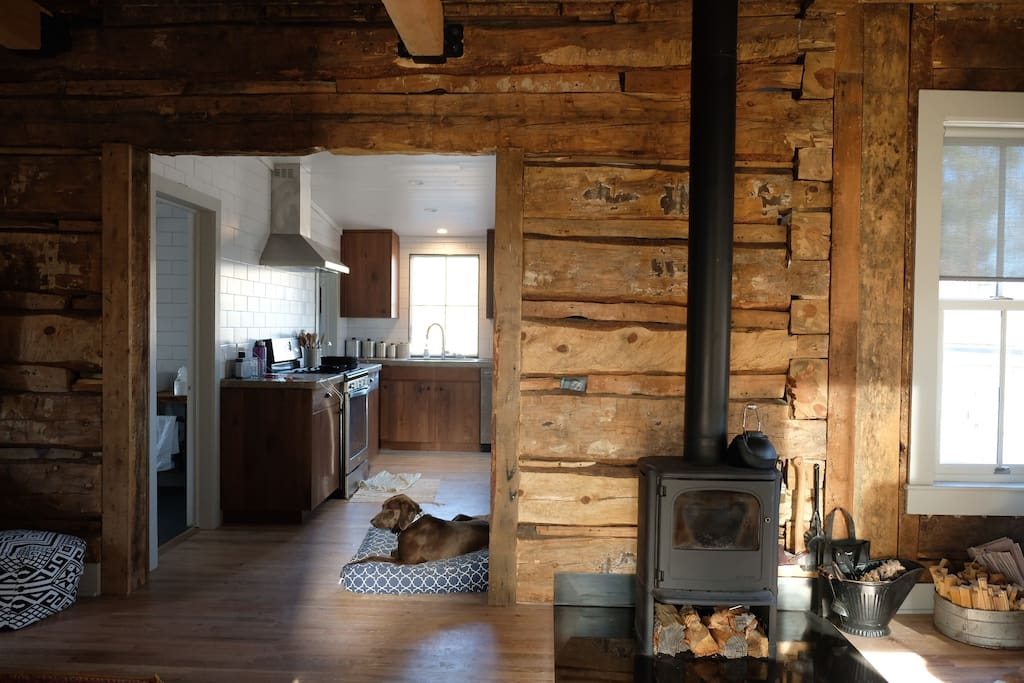 The Main Room of the cabin includes a Morsö wood burning stove as a supplemental heat source, and there is additional firewood located on the property.