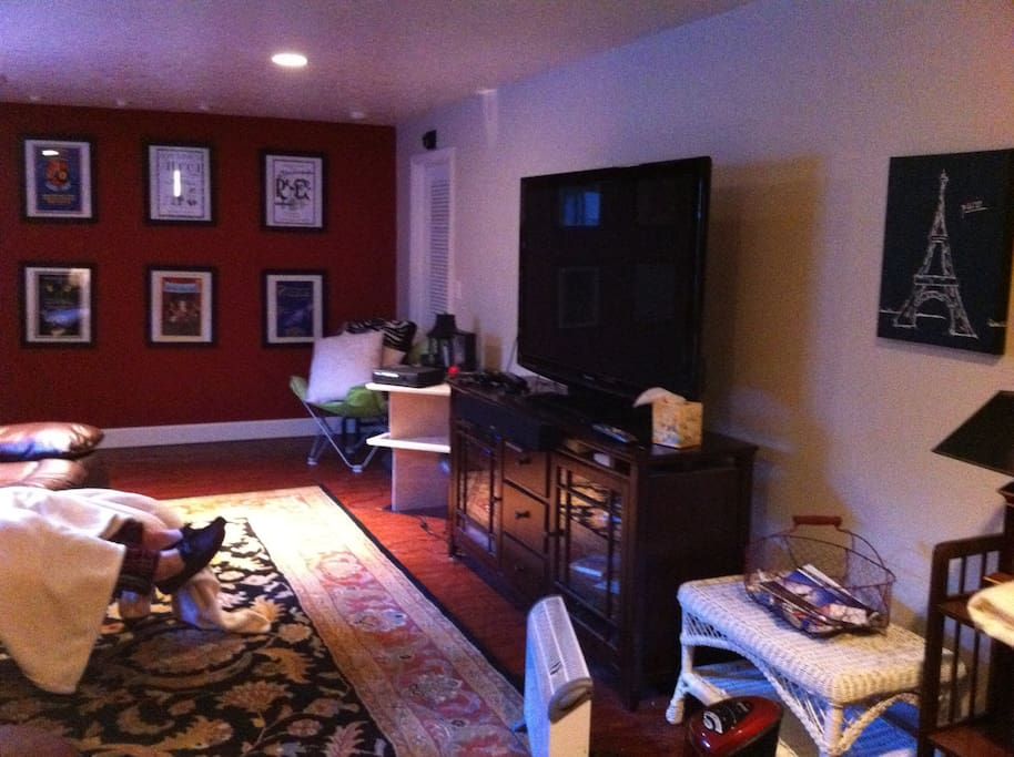 Huge flat screen tv and reclining couch