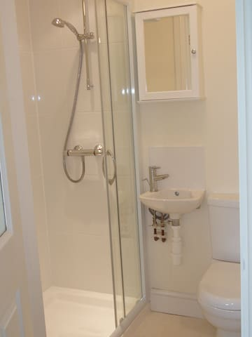 Shower room with free soap/shampoo and toilet