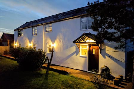 Spacious cottage with private garden. Sleeps 4.