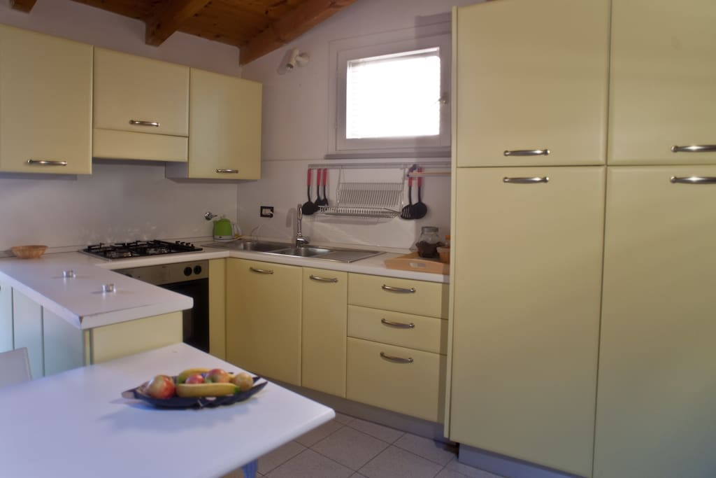 Fully equipped kitchen with oven and microwave oven