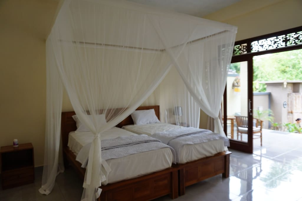 Comfy twin beds with mosquito net ---- can also be combined into one double bed