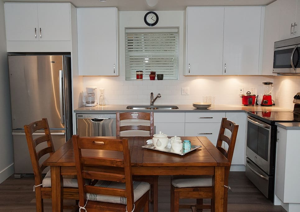 Spacious and modern kitchen with lots of amenities for cooking and sharing a meal