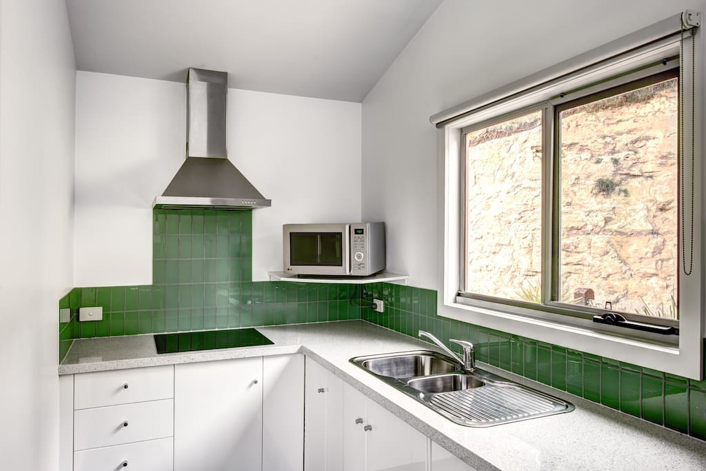 Stone bench, induction cooktop modern appliances