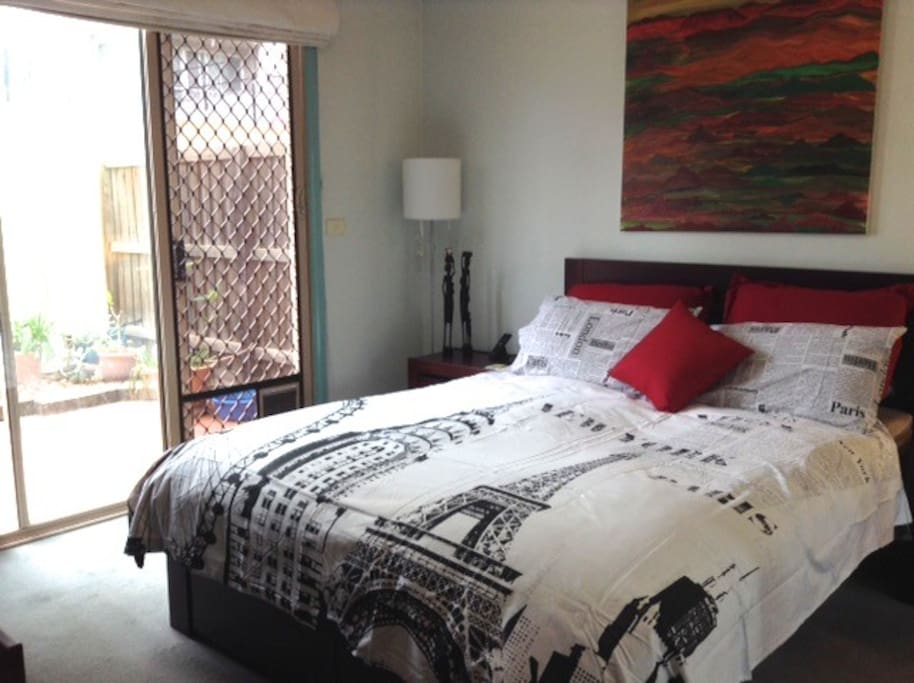 Bedroom 2 with access to rear private courtyard