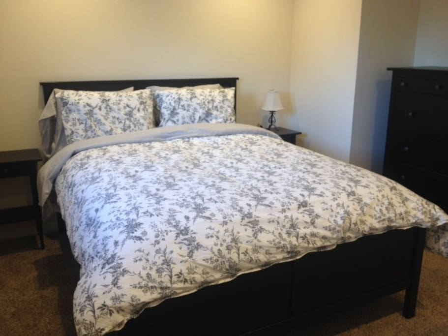 Queen sized bed, full dresser, and closet with ample space for two people.