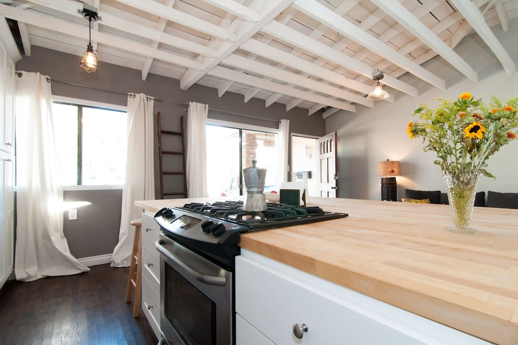 Kitchen and living room allow you to be a part of the party while cooking