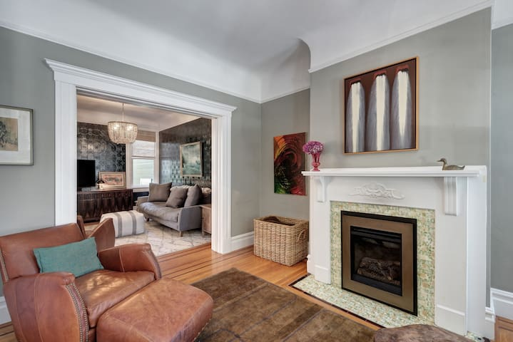 Family room and living room with pocket doors and new gas fireplace