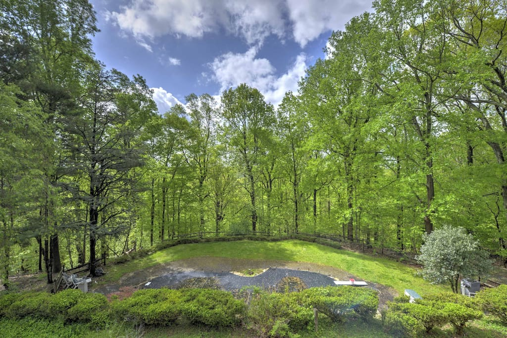 Nestled within a heavily wooded area, this home offers breathtaking views!